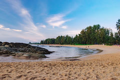 View of calm sea with stones and vacationers Stock Image