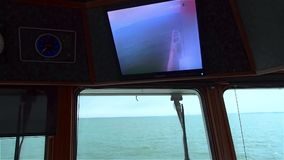 View of calm turquoise sea through window of ship. Clear day. stock video footage