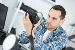 View camera lens with magnifying glass. Man Stock Images