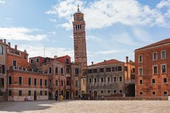 View of Campo S. Anzolo and learning Campanile of S. Stefano church stock photos
