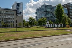 Logo of the Delft University of Technology on the campus, Netherlands. View on the campus of the Delft University of Technology, Netherlands and logo of the royalty free stock photography