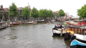 View of a canal in Amsterdam. Canal in Amsterdam, The Netherlands stock video footage