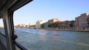 View on canal and beautiful buildings from window of touristic boat, Venice. Stock footage stock video footage
