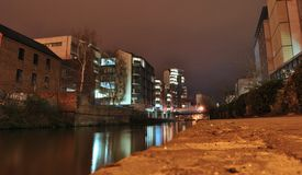 View on the canal and city landscape or cityscape at night, water reflection of shining lights, Trent street, Nottingham, UK Royalty Free Stock Photography