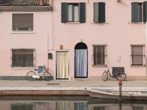 View of the canal of Comacchio. Reflection in the water. Two ent Stock Photos
