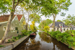 View at a canal in a Dutch historic village Royalty Free Stock Photo