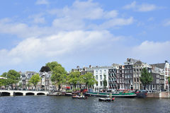 View on a canal with Meager Bridge on the background, Amsterdam, Netherlands. View on a canal with famous Meager Bridge on the background, Amsterdam, The Stock Photography