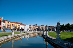 View from the canal in Padova. View of the canal with statues on prato della Valle in Padova, Veneto, Italy Royalty Free Stock Image