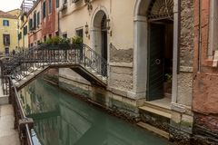 View of canal in Venice whis small bridge. Architecture and landmarks of Venice. Italy stock photography
