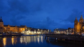View of Canals and Harbor in Amsterdam at night Royalty Free Stock Images