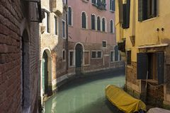View into the canals of the lagoon city of Venice. Typical are the boats. And the houses built right on the water stock images