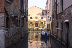 View into the canals of the lagoon city of Venice. Typical are the boats. And the houses built right on the water stock image