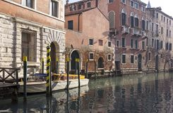 View into the canals of the lagoon city of Venice. Typical are the boats. And the houses built right on the water royalty free stock photos