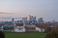 View of Canary Wharf from Greenwich Hill at dusk Stock Images