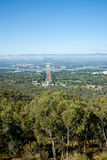 View of Canberra. View of Canberra, Australia, from high up on Mount Ainslie. Gum trees iconic Australian vegetation in foreground Royalty Free Stock Image