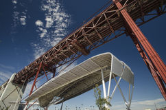 View of canopy and 25th April Bridge, Lisbon Royalty Free Stock Photos
