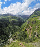 View of the canyon of White Aragvi river, Georgia. View of the canyon of White Aragvi river from the lookout platform on the Cross Pass Gudauri Pass, Caucasus Royalty Free Stock Photos