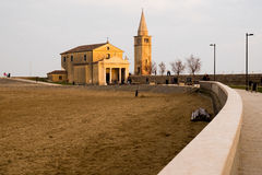 View of caorle church on the beach during winter sunset. Caorle church on  beach seen during sunset in winter Stock Images