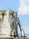 View of cape with arch on beach of Etretat Stock Photo
