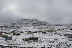 View of Cape Dorset Nunavut with a layer of snow on the ground, a northern Inuit community. In arctic Canada Royalty Free Stock Photography