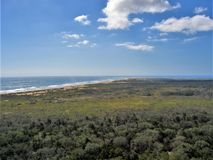 View from Cape Hatteras Lighthouse. Cape Hatteras Lighthouse is 198 feet tall and a climb of 268 steps will take you to the top for this view of Hatteras Island Stock Photography