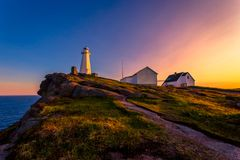 Cape Spear Lighthouse at Newfoundland. View of Cape Spear Lighthouse at Newfoundland, Canada, during sunset stock photography