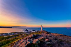 Cape Spear Lighthouse at Newfoundland. View of Cape Spear Lighthouse at Newfoundland, Canada, during sunset royalty free stock photography