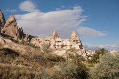 View of Cappadocia. Turkey. A geological formation consisting of volcanic tuff with cave dwelling. Cave monastery in Goreme Centra. L Anatolia. Cloudy sky Royalty Free Stock Images