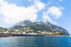 View of  Capri island on the boat. Panorama view of Capri Island on the boat from the Mediterranean Sea Stock Photo