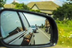 View of car mirror. View in the car during the day selective focus Royalty Free Stock Images