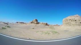View of car driving in Yardang Landform Gansu, China. stock footage