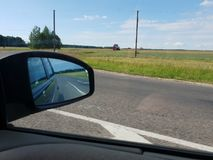 Traffic view of road in mirror while driving royalty free stock images