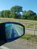 Traffic view of road in mirror while driving stock photography