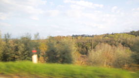 View from a car passenger window looking at the passing farmland. stock footage