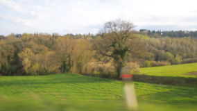 View from a car passenger window looking at the passing farmland. stock video footage