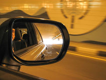 View in car rear mirror at tunnel in the evening Stock Photography