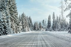 View from a car riding through snow covered winter road stock image