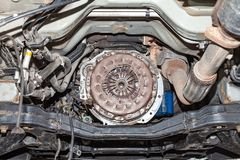 View of the car`s clutch basket during the repair of a car lifted on a lift in a vehicle maintenance workshop. Industry in the stock photos