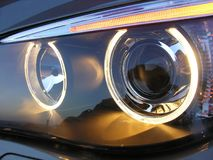 A view of a car`s left headlight on. stock photo
