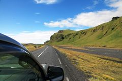 View from the car to Icelandic road and mountains. In summer Royalty Free Stock Photos