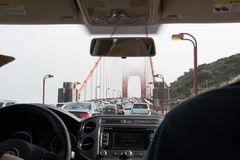 View of the car traffic on Golden Gate Bridge, San Francisco, CA. A view of the car traffic on the Golden Gate Bridge, San Francisco, CA as seen from inside a stock image
