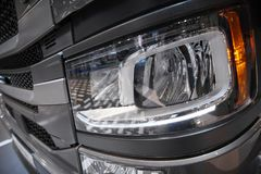 View on car truck cabin front light with hard plastic cover. Car light close up. Truck hood cabin cover. Car truck led light. Styl stock photos