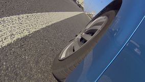 View of car wheel moving on asphalt city road, taxi service, high quality tires. Stock footage stock video footage
