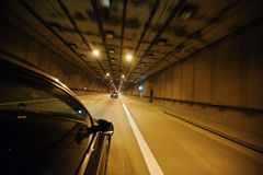 View from the car window, car moving through the tunnel at light stock images