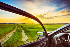 View From Car Window. Dirty Rural Road In Field, Meadow, Countryside. View From Car Window. Freedom And Dream Concept royalty free stock photography