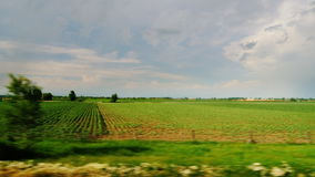 View from the car window - drive through the picturesque countryside and fields. 10 bit ProRes codec stock footage
