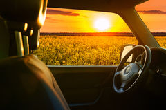 View from car window on the field at sunset Royalty Free Stock Photography