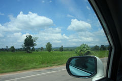 View from car window on rice field Royalty Free Stock Photography