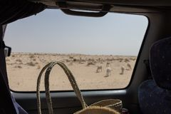 A view from the car window in the Sahara desert near the city of Tozeur, Tunisia stock photos