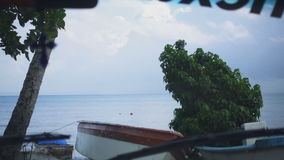 The view from the car window of the sea gulf and the blue sky. In slow-motion stock video footage